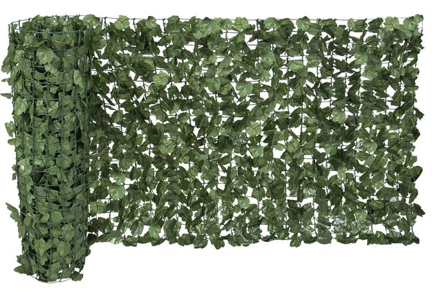 Mask chain-link fences with a convincing roll of artificial ivy.