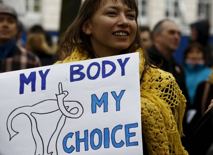 "The new law would allow abortion only in cases where the woman is in ""imminent"" life-threatening danger, and it would otherwise punish those seeking abortions — and medical providers performing them — with five years in jail."