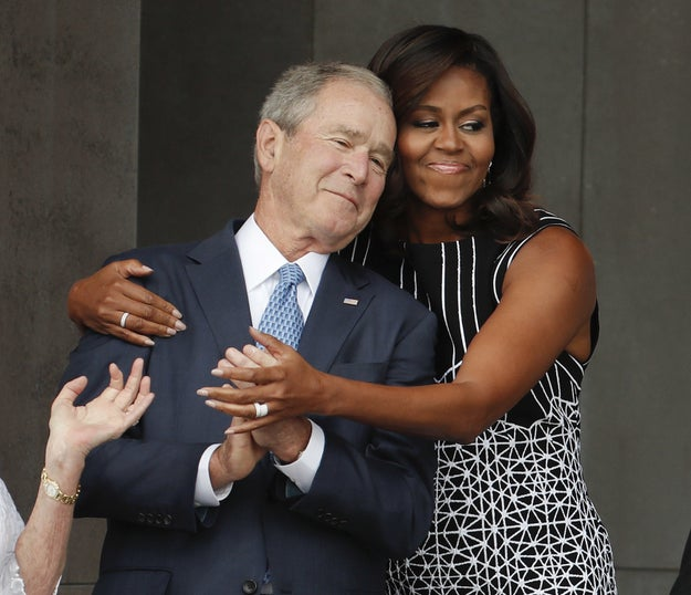 First Lady Michelle Obama wrapped George W. Bush in an adorable hug.