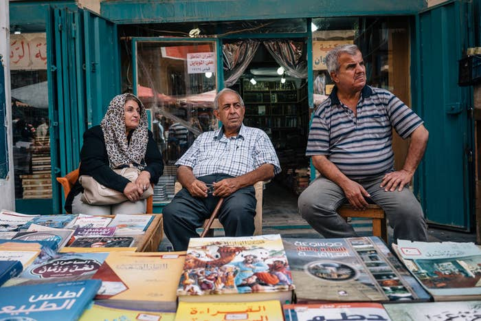 Iraqis spend their Friday afternoon at Baghdad's Mutannabi Street book market.