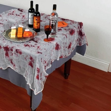 Set your dining table with a bloody gauze cover to appeal to everyone's taste buds.