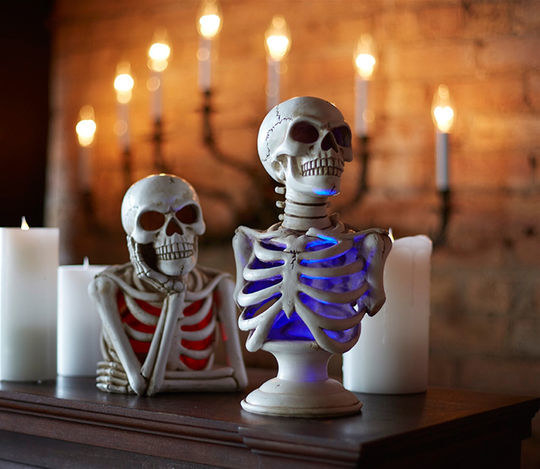 Prop a few color-changing skeleton table pieces to keep you and your guests company.