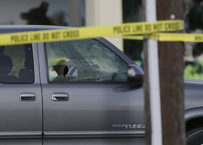 A car's windows are shattered by bullets at the scene of a shooting in Houston.