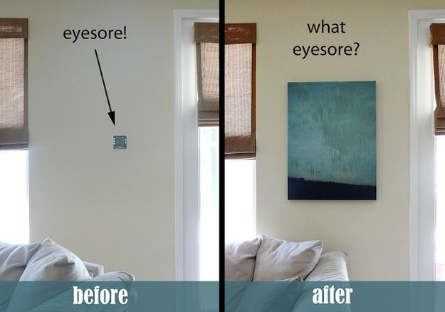 Conceal a thermostat or security system by hanging a canvas wall art piece on hinges.