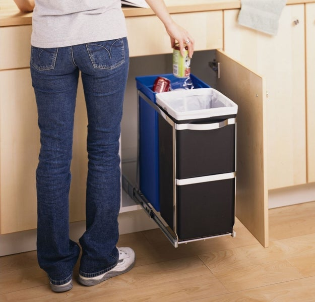 Stash your trash and recycling beneath the counter with a rolling system.
