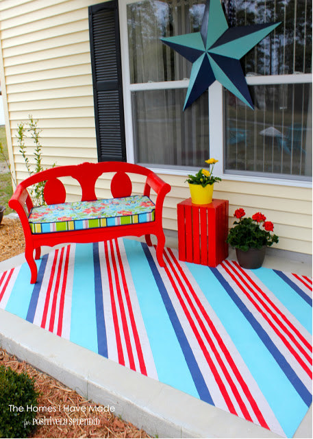 Paint a drop cloth as a cheerful outdoor rug to hide stained concrete or ugly patio surfaces.
