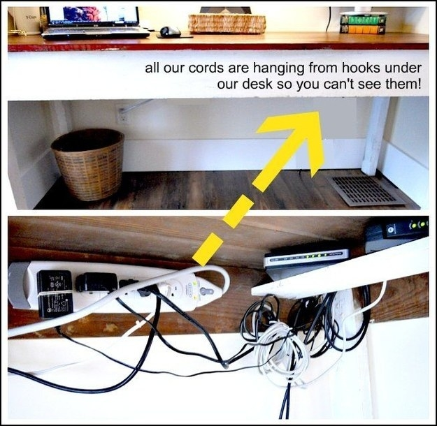 Mount a surge protector and coil up cords on hooks underneath a desk to fight visual cord clutter.