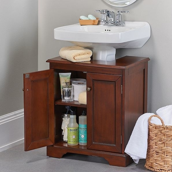 Find a happy medium between a pedestal sink and vanity by fitting a specially designed cabinet around the sink base.