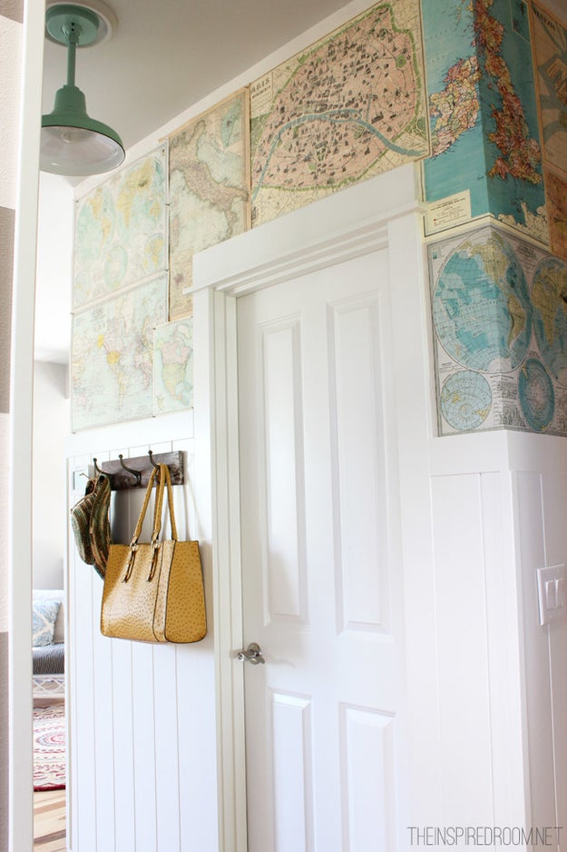 Cover up a paint-color fail with worldly maps and push pins.