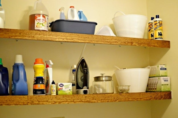 Disguise wire shelving as floating wood shelves that you can take with you when you leave.