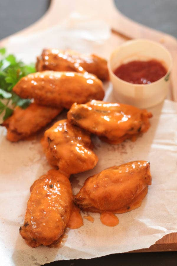 12 deliciously crispy chicken wings that are perfect for game day buffalo sauce chicken wings recipe here forumfinder Images