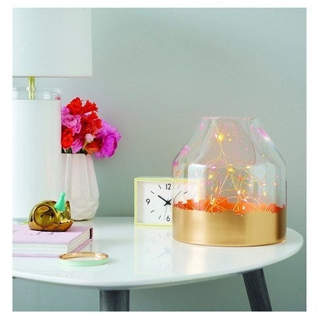 Get these copper, battery-powered lights from Target for $12.99. And get a similar vase from Amazon for $27.