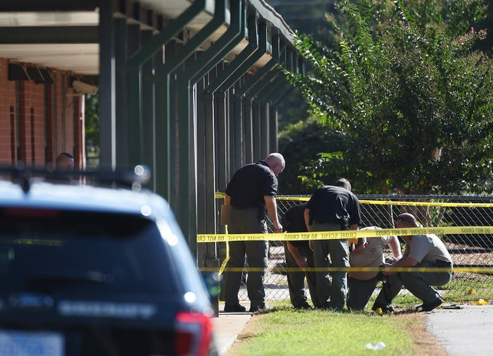Members of law enforcement investigate an area at Townville Elementary School.