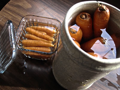 Keep carrots crisp by storing them in water after removing their leafy tops.
