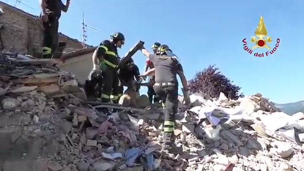 The couple survived the collapse of their home, but couldn't find their dog until they returned Friday with firefighters to retrieve some belongings.