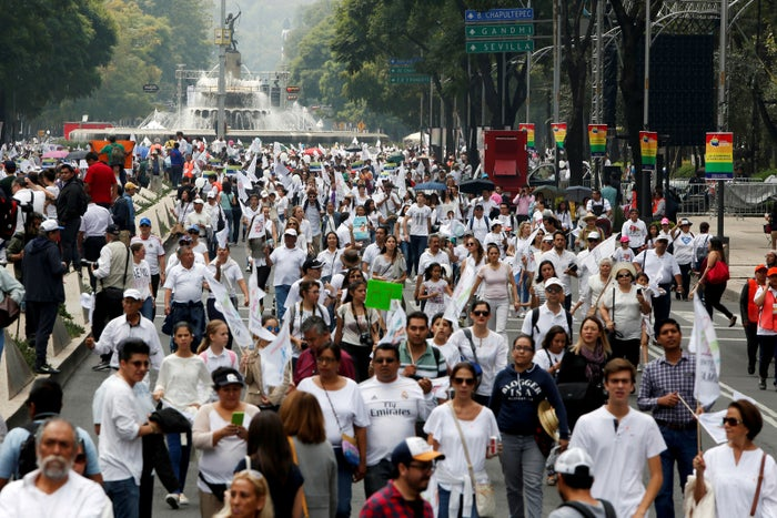 People dressed in white arrive to participate in a march on Sept. 24 in Mexico City against the legalization of marriage equality.