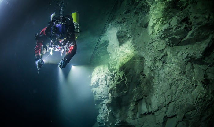 Czech Republic is seen examining the limestone crevasse in the flooded Hranicka Abyss.
