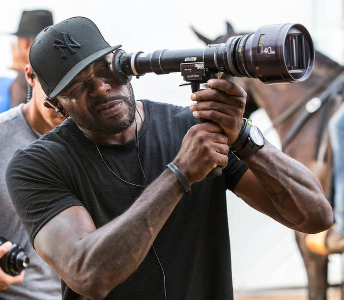 Director Antoine Fuqua on the set of The Magnificent Seven.