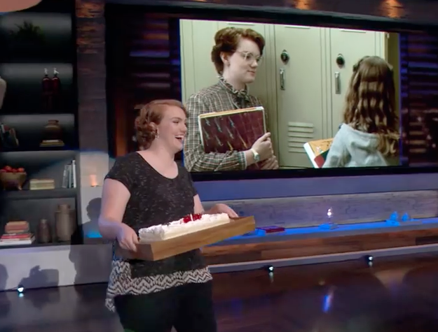 And Shannon just rolls on in carrying a cute-ass cake.