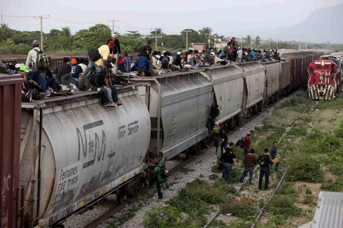 Central American migrants ride a freight train during their journey toward the US border in Ixtepec, Mexico.