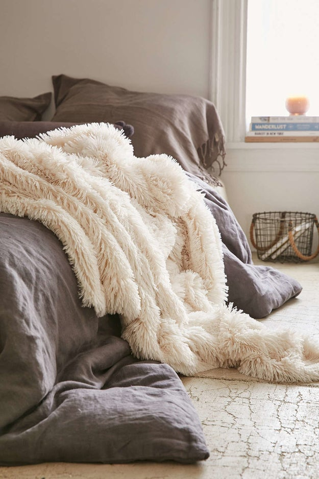 A faux lamb fur throw that'll make you feel like you live at Winterfell.