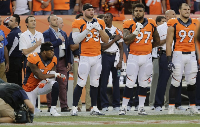 Denver Broncos inside linebacker Brandon Marshall (54) kneels on the sideline during the National Anthem prior to an NFL football game against the Carolina Panthers, Thursday, Sept. 8, 2016, in Denver. (AP Photo/Joe Mahoney)