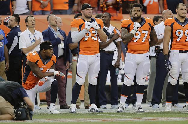 Denver Broncos' Brandon Marshall Takes A Knee During National Anthem