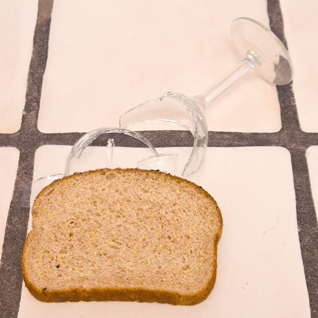 Pick up broken glass with a slice of bread.