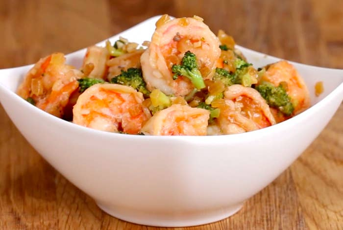 Serves 4INGREDIENTS1 pound large shrimp, peeled and deveined3 cloves garlic, minced2 cups broccoli florets½ onion, diced1 tablespoon low-sodium soy sauce2 tablespoons sesame oil, divided½ teaspoon salt, dividedPREPARATION1. Heat 1 tablespoon of sesame oil in a large, nonstick skillet over medium heat.2. Pour in the shrimp and season with ¼ teaspoon of the salt. 3. Fry the shrimp for 1 minute on each side.4. Remove the shrimp from the pan and pour in the remaining 1 tablespoon of oil.5. Toss in the onion, broccoli, and remaining ¼ teaspoon of salt and sauté for a few minutes until they begin to soften. 6. Add in the garlic and soy sauce and sauté until the garlic is fragrant, about 30 seconds.7. Toss the shrimp back into the pan and mix until everything is well incorporated and the shrimp is fully cooked, about 1 minute.8. Divide the mixture evenly between 4 bowls.9. Enjoy!
