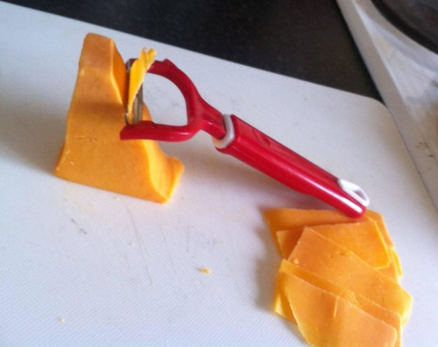 Use a potato peeler to cut thin, even slices of cheese.