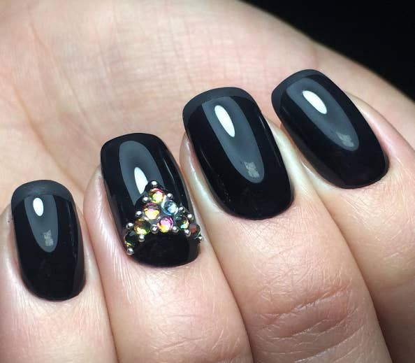 If you're into more of a minimalist look, but you want to add your own  touch, this design is for you: - 16 Ideas For Black Nail Polish That You'll Love If You Have A Cold