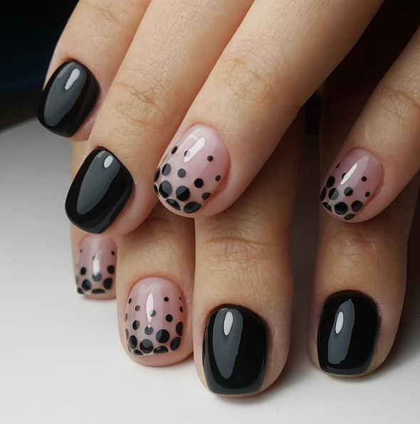 And don't worry about whether your nails are long enough to pull it off. Black polish works on short nails, too.
