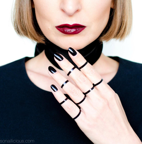 If you want to take the design past the nails, pair the black polish with some black ribbons.