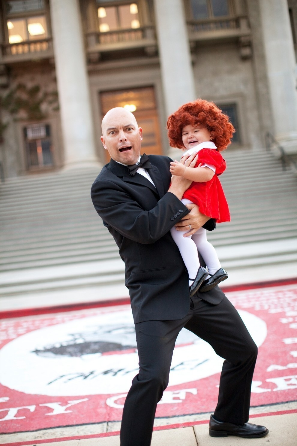Since then she's dressed up as Annie alongside her dad, Christopher, as Daddy Warbucks...
