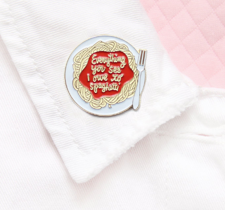 An enamel pin that shows how important spaghetti is to your life.