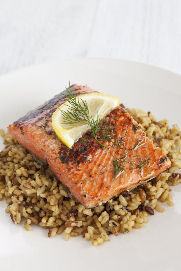 A small portion of lemon pepper salmon and brown rice.
