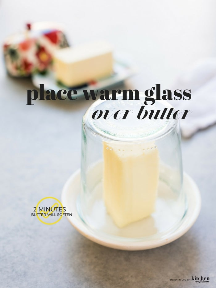 Microwaves are good for melting butter, but trying to just soften butter in the microwave always ends badly — the outsides melt while the insides stay cold. A quick, neat alternative is to soften it by placing a warm glass over the butter. This'll get it just soft enough to work into your cake mix. More here.