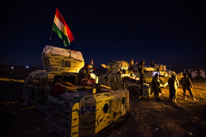 Peshmerga forces spend the night at the front line outside Mosul.