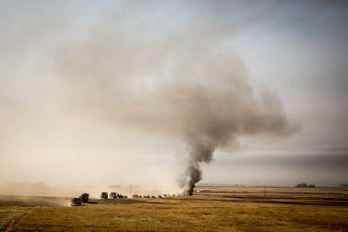 A peshmerga convoy moves toward villages outside Mosul.