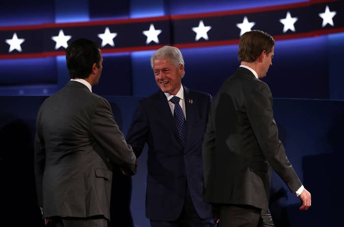 Bill Clinton shakes the Trump sons' hands at the second presidential debate.