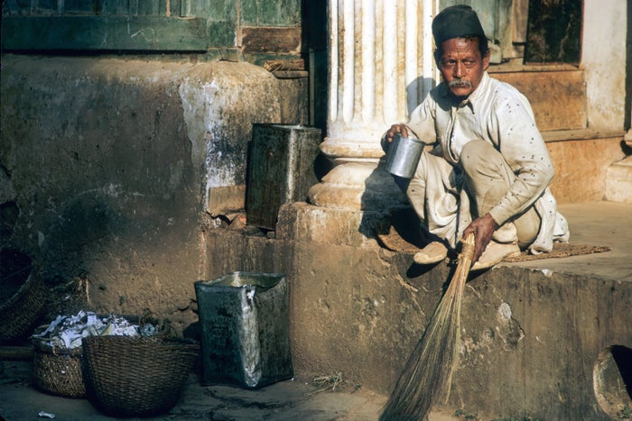 Untouchability is commonly upheld through a prohibition on sharing of water and cooked food. During a morning break at Pharping Boarding School, everyone was served tea in ceramic tea cups, except for this sweeper, who, because of his caste, was given his tea in an empty tin can.