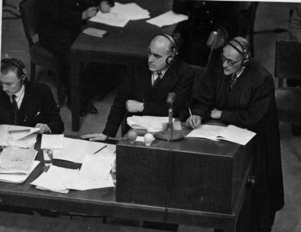 Sir David Maxwell-Fyfe (centre) listens to evidence at the Nuremberg trials in 1946.