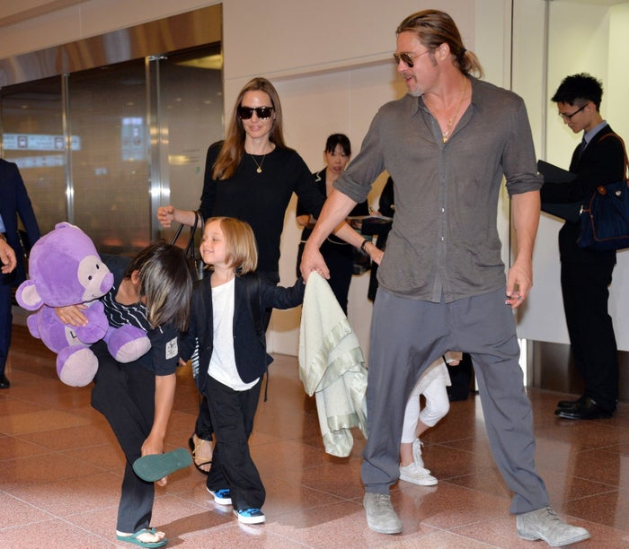 Brad Pitt and Angelina Jolie accompanied by their children in Tokyo in 2013.
