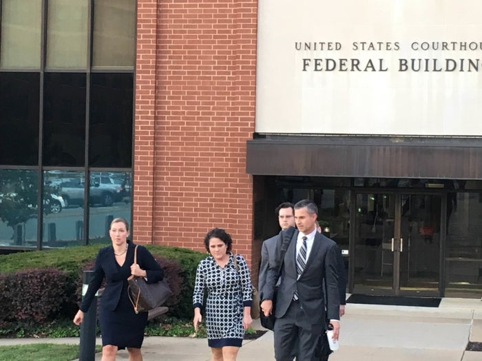 Nicole Eramo is seen leaving the federal courthouse in Charlottesville with attorneys Libby Locke, Tom Clare, and Andy Phillips.