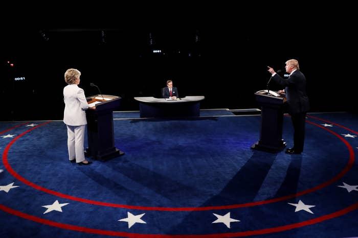 Donald Trump speaks as Hillary Clinton looks on during the third US presidential debate on October 19, 2016, in Las Vegas.