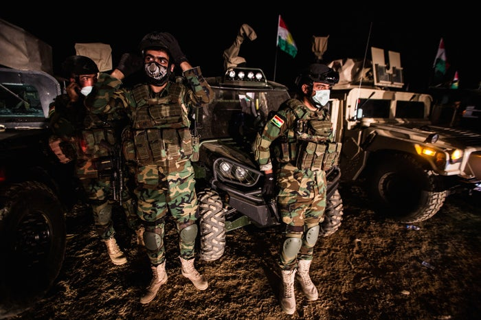 Kurdish special forces get ready the night before they will head out on a mission to go deep in ISIS territory.