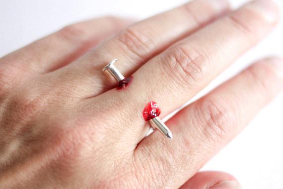 Nail Through Finger Ring