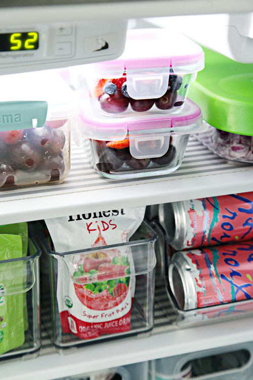When it comes to making it easy to clean your fridge and preventing spills in the future, bins are your best friend.