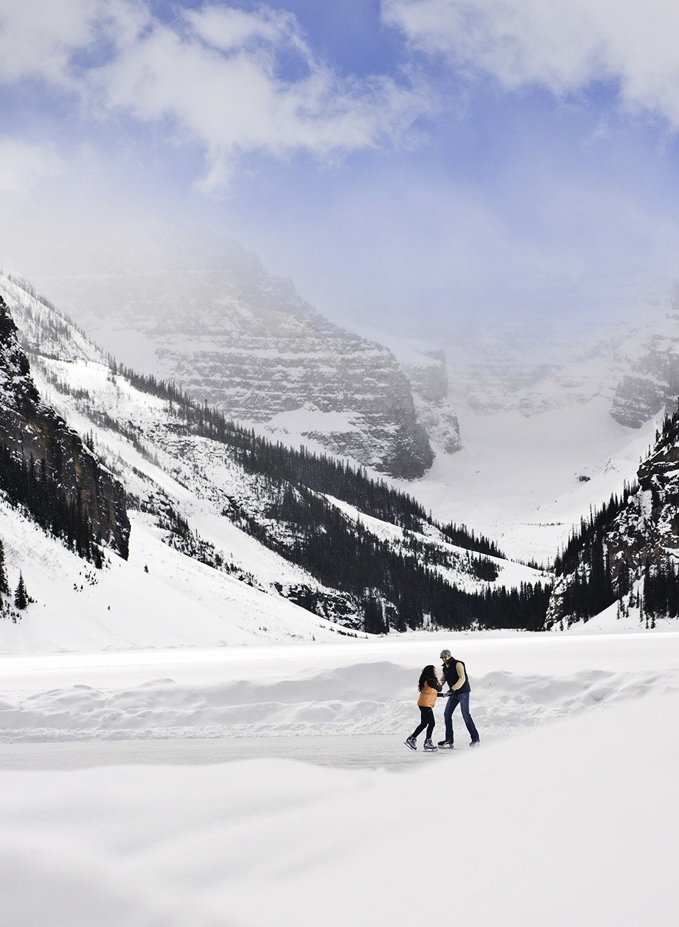 If you think Lake Louise is beautiful in the summertime, you should see the glacial lake when it freezes over in the winter!