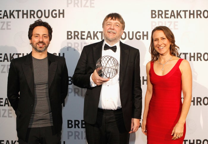 Wojcicki with Google co-founder and ex-husband Sergey Brin and neuroscience professor John Hardy at the 2016 Breakthrough Prize Ceremony.